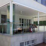 Ventajas de instalar cortinas de cristal para ganar espacio en casa